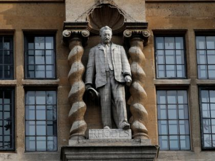 A statue of British businessman and imperialist Cecil John Rhodes is pictured outside Oriel College at the University of Oxford in Oxford, west of London on June 9, 2020, during a protest calling for its removal. - Thousands of people on Tuesday called for a statue of the 19th century …