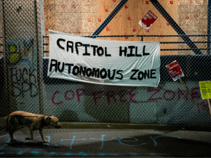 "SEATTLE, WA - JUNE 09: A ""Capitol Hill Autonomous Zone"" sign hangs on the exterior of the Seattle Police Departments East Precinct on June 9, 2020 in Seattle, Washington. Protests have continued in many parts of the city including inside City Hall and around the Seattle Police Departments East Precinct, …"
