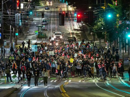 SEATTLE, WA - JUNE 09: Demonstrators march to the Seattle Police Departments East Precinct after marching inside Seattle City Hall, led by Seattle City Council member Kshama Sawant, on June 9, 2020 in Seattle, Washington. Protests have continued in many parts of the city including around the Seattle Police Departments …