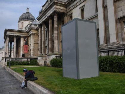 "LONDON, ENGLAND - JUNE 12: A protective barrier is seen around the statue of George Washington in Trafalgar Square in anticipation of protests today on June 12, 2020 in London, England. Outside the Houses of Parliament, the statue of former Prime Minister Winston Churchill was spray-painted with the words ""was …"
