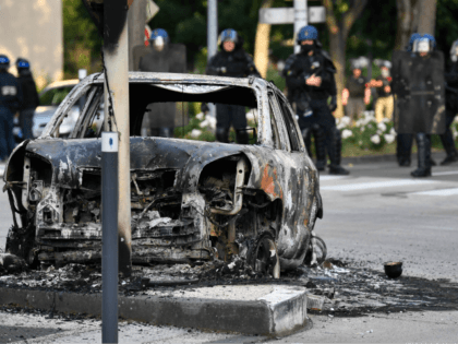 Gendarmes stand near a burnt car in the Gresilles area of Dijon, eastern France, on June 15, 2020, as new tensions flared in the city after it was rocked by a weekend of unrest blamed on Chechens seeking vengeance for an assault on a teenager. - Police sources said the …