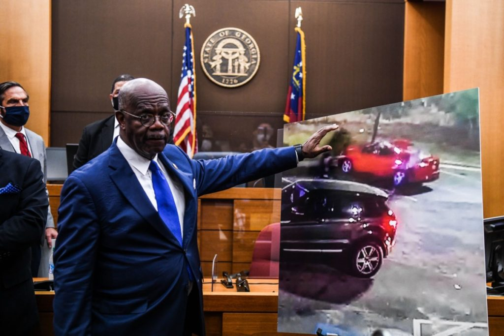 Fulton County District Attorney Paul L. Howard Jr. point at a picture displayed inside the courtroom as he announces 11 charges against former Atlanta Police Officer Garrett Rolfe on June 17, 2020, in Atlanta, Georgia. - An Atlanta police officer will be charged with murder for shooting a 27-year-old man in the back, justice officials announced June 17 in the latest case to spark anger over police killings of African Americans. (Photo by CHANDAN KHANNA / AFP) (Photo by CHANDAN KHANNA/AFP via Getty Images)