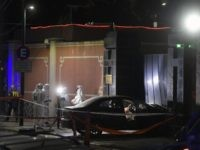 View of scientific police next to the car which deliberately crashed into the entrance of China's embassy in Buenos Aires, Argentina, on June 22, 2020 during the lockdown imposed by the government against the spread of the new coronavirus, COVID-19. - According to local media, the driver was identified as …