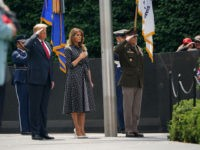 US President Donald Trump and First Lady Melania Trump pay their respects as they visit the Korean War Veterans Memorial in Washington, DC on June 25, 2020. - North and South Korea on June 25, 2020 separately marked the 70th anniversary of the start of the Korean War, a conflict …