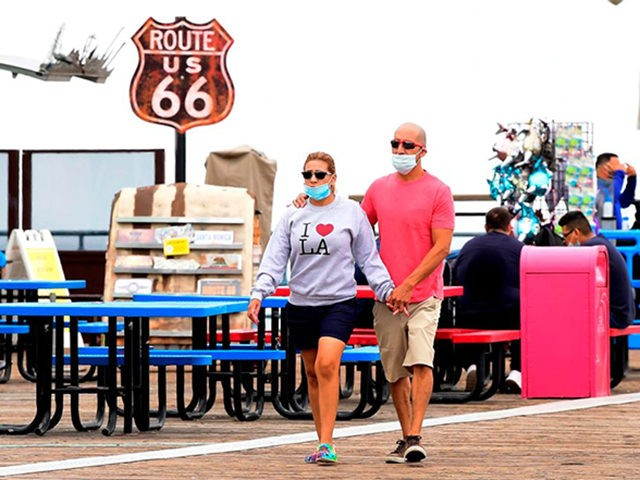 A couple wearing facemasks visits Santa Monica Pier Santa Monica Pier which re-opened on June 25 after closure for over three months due to the coronavirus pandemic, on June 26, 2020 in Santa Monica, California. - A gradual re-opening of businesses continues across the state, despite a continued rise in …