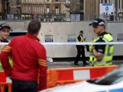 Police officers staff a cordon in central Glasgow on June 27, 2020 following a stabbing incident at the Park Inn hotel the previous day. - Scottish police on June 26 shot dead the suspect in a multiple stabbing at a Glasgow hotel housing asylum seekers that wounded six people, including …
