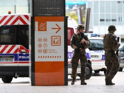 French servicemen patrol in La defense business district, west of Paris on June 30, 2020 after police received a call reporting the presence of an armed man. (Photo by CHRISTOPHE ARCHAMBAULT / AFP) (Photo by CHRISTOPHE ARCHAMBAULT/AFP via Getty Images)