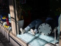 NEW YORK, NEW YORK - JUNE 01: A mannequin lies in broken glass at American Eagle Outfitters in the Soho district of Manhattan on June 01, 2020 in New York City. Cleaning and construction teams worked to board up storefronts of dozens of shops damaged during clashes between police and …