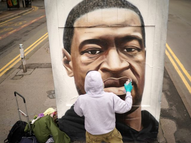 MANCHESTER, UNITED KINGDOM - JUNE 03: Graffiti artist Akse spray paints a mural of George Floyd in Manchester's northern quarter on June 03, 2020 in Manchester, United Kingdom. The death of an African-American man, George Floyd, while in the custody of Minneapolis police has sparked protests across the United States, …