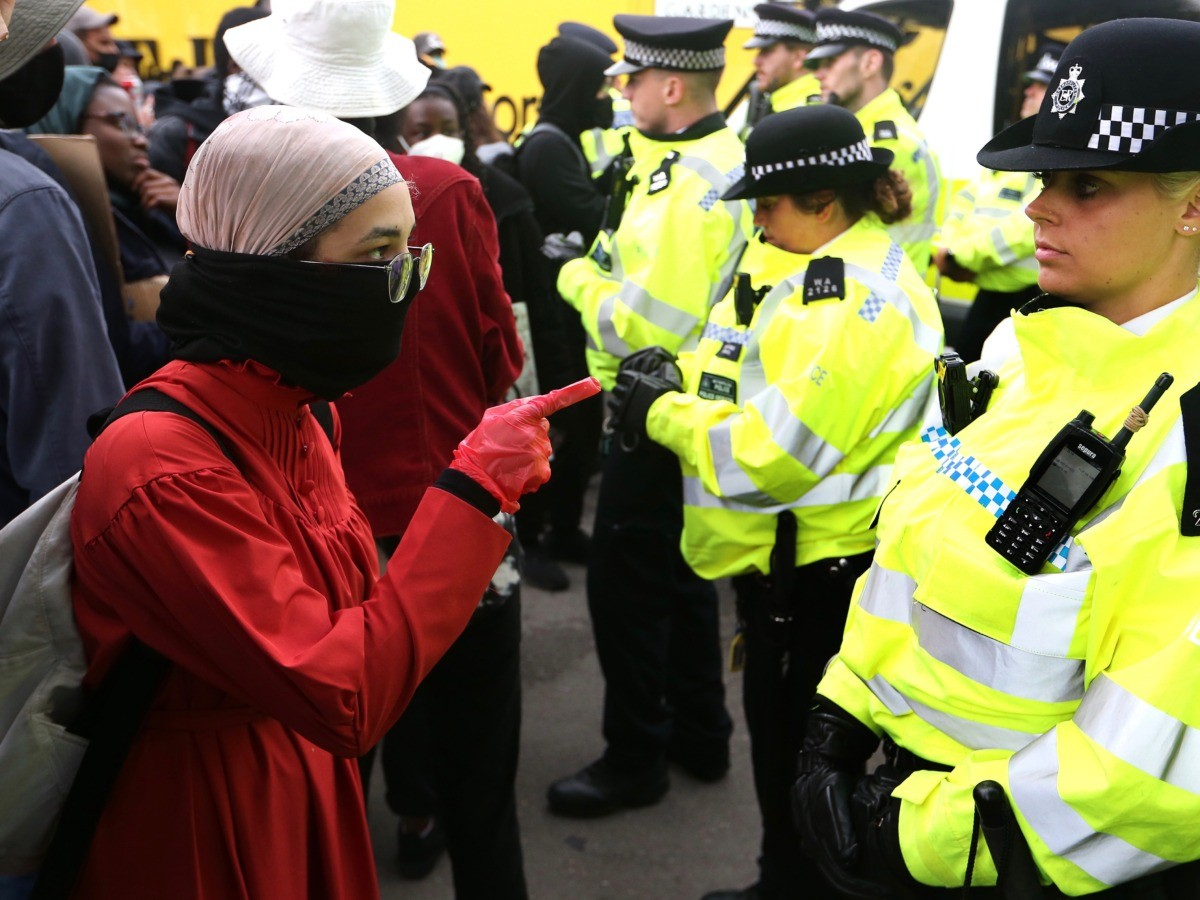LONDON, UNITED KINGDOM - JUNE 06: A protester confronts a police officer during a Black Lives Matter protest on June 06, 2020 in London, United Kingdom. The death of an African-American man, George Floyd, while in the custody of Minneapolis police has sparked protests across the United States, as well as demonstrations of solidarity in many countries around the world. (Photo by Alex Pantling/Getty Images)