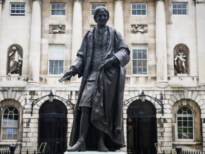 LONDON, ENGLAND - JUNE 08: A statue of Sir Thomas Guy is seen outside Guy's Hospital on June 08, 2020 in London, England. Sir Thomas Guy Became made his fortune through ownership of a very large amount of shares in the South Sea Company, whose main purpose was to sell …