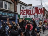 BARKING, ENGLAND - JUNE 09: A Black Lives Matter protest takes place in Barking town centre on June 09, 2020 in Barking, United Kingdom. The death of an African-American man, George Floyd, while in the custody of Minneapolis police has sparked protests across the United States, as well as demonstrations …