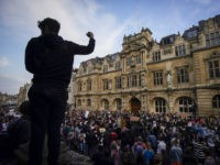 OXFORD, ENGLAND - JUNE 09: Demonstrators gather outside University of Oxford's Oriel College during a protest called by the Rhodes Must Fall campaign on June 09, 2020 in Oxford, England. The Rhodes Must Fall campaign protests outside University of Oxford's Oriel College where a statue of imperialist Cecil John Rhodes …