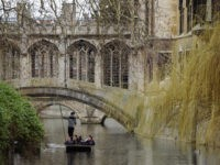 CAMBRIDGE, UNITED KINGDOM - MARCH 13: Members of the public punt along the river Cam on March 13, 2012 in Cambridge, Cambridgeshire. Cambridge has a student population in excess of 22,000 spread over 31 different independent Colleges across the city. The city is home to several famous University's, including The …