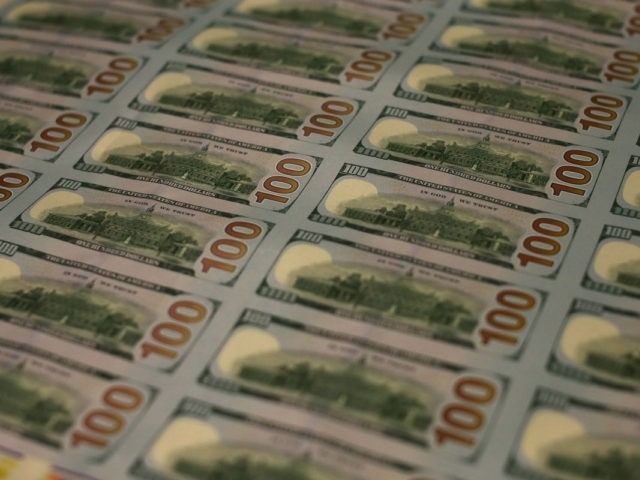 WASHINGTON, DC - MAY 20: Newly redesigned $100 notes lay in stacks at the Bureau of Engraving and Printing on May 20, 2013 in Washington, DC. The one hundred dollar bills will be released this fall and has new security features, such as a duplicating portrait of Benjamin Franklin and …