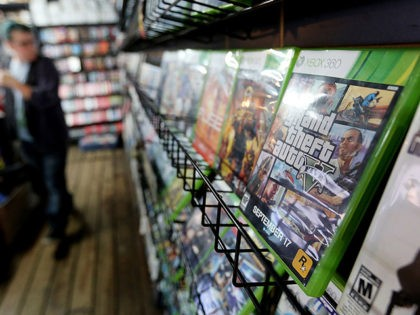 NEW YORK, NY - SEPTEMBER 18: A display copy of Grand Theft Auto V (R) sits on a shelf at the 8 Bit & Up video games shop in Manhattan's East Village on September 18, 2013 in New York City. The video game raked in more than $800 million in …