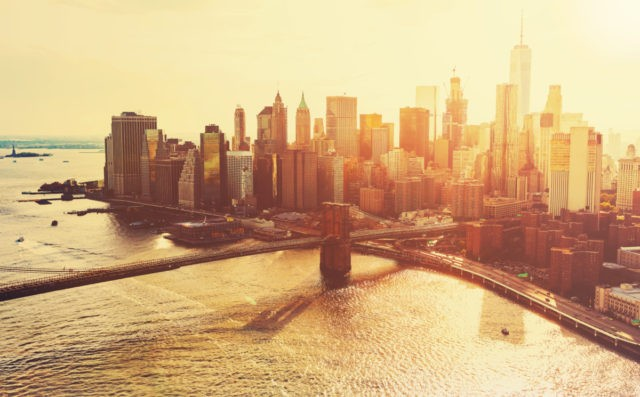Brooklyn Bridge over the East River in New York City at sunset