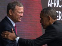 US President Barack Obama shakes hands with Chief Justice of the US Supreme Court John Roberts after speaking during the opening ceremony for the Smithsonian National Museum of African American History and Culture September 24, 2016 in Washington, D.C. / AFP / ZACH GIBSON (Photo credit should read ZACH GIBSON/AFP …