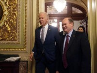 US Vice President Joe Biden walks out of the Senate chamber with US Democratic Senator from Delaware Chris Coons after attending a bipartisan tribute honoring Biden's service as a member of the Senate and as vice president, at the Capitol in Washington, DC, on December 7, 2016. / AFP / …