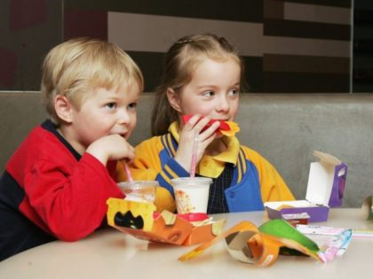 MELBOURNE, AUSTRALIA - AUGUST 29: Children eat a new Happy Meal at the McDonald's restaurant in Collingwood on August 29, 2006 in Melbourne, Australia. The new Happy Meal is a low fat alternative to the fast food chain's traditional Happy Meal. Childhood obesity is a major health issue in Australia …