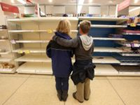 TEWKESBURY, UNITED KINGDOM - JULY 23: A mother and her son look at the empty bakery shelves in a supermarket on July 23 2007 in Tewkesbury, England. Flooding has caused wideswept disruption across the country with further regions braced for more floods. (Photo by Matt Cardy/Getty Images)