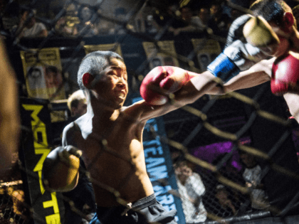 This picture taken June 2, 2017 shows Jihushuojie (L), 12, and Abieamu, 13, fighting in an underground fight club in Chengdu. Abieamu and Jihushuojie are among the kids from the Tibetan plateau who were adopted into the Enbo Fight Club in Chengdu, the capital of Sichuan province. Though most of …