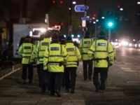 Police officers patrol the area around Old Trafford stadium prior to the UEFA Champions League group A match between Manchester United and CSKA Moscow at Old Trafford on December 5, 2017 in Manchester, north-west England. Britain and Russia may have tense political relations, but -- in football policing at least …
