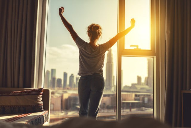 Woman in apartment in the morning