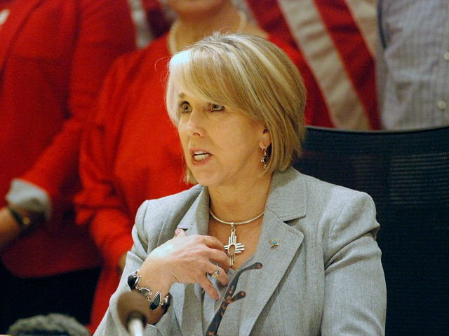 New Mexico Gov. Michelle Lujan Grisham signed a red-flag gun bill Tuesday, Feb. 25, 2020, in Santa Fe, N.M., that allows state district courts to order the temporary surrender of firearms. The Democratic governor urged sheriffs to resign if they refuse to enforce the new law that can temporarily remove …