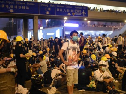 Demonstrators occupy a street the night after a protest against a controversial extradition law proposal in Hong Kong on June 12, 2019. - Violent clashes broke out in Hong Kong on June 12 as police tried to stop protesters storming the city's parliament, while tens of thousands of people blocked …
