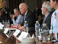 WASHINGTON, DC - DECEMBER 13: U.S. Vice President Joe Biden speaks during a roundtable on the Cancer Moonshot Initiative as comedian Jon Stewart looks on December 13, 2016 at Eisenhower Executive Office Building in Washington, DC. Biden held a roundtable to discuss military and first responder care. (Photo by Alex …