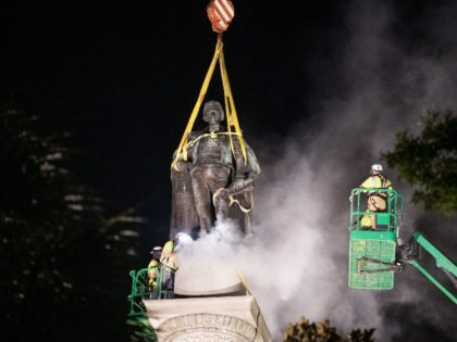 CHARLESTON, SC - JUNE 24: A worker uses a saw at the foot of the statue of John C. Calhoun atop the monument in his honor at Marion Square on June 24, 2020 in Charleston, South Carolina. Work crews began dismantling the monument in Tuesday evening. (Photo by Sean Rayford/Getty …
