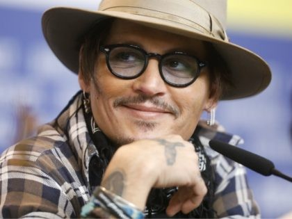 Actor Johnny Depp attends a news conference for the film Minamata during the 70th International Film Festival Berlin, Berlinale in Berlin, Germany, Friday, Feb. 21, 2020. (AP Photo/Markus Schreiber)