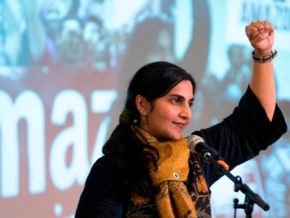 "Seattle City Councilmember Kshama Sawant addresses supporters during her inauguration and ""Tax Amazon 2020 Kickoff"" event in Seattle, Washington on January 13, 2020. (Photo by Jason Redmond / AFP) (Photo by JASON REDMOND/AFP via Getty Images)"