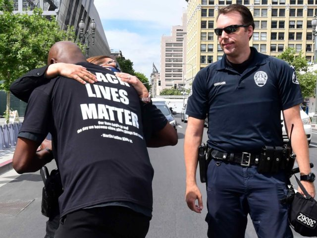 LAPD hug (Frederic J. Brown / AFP / Getty)