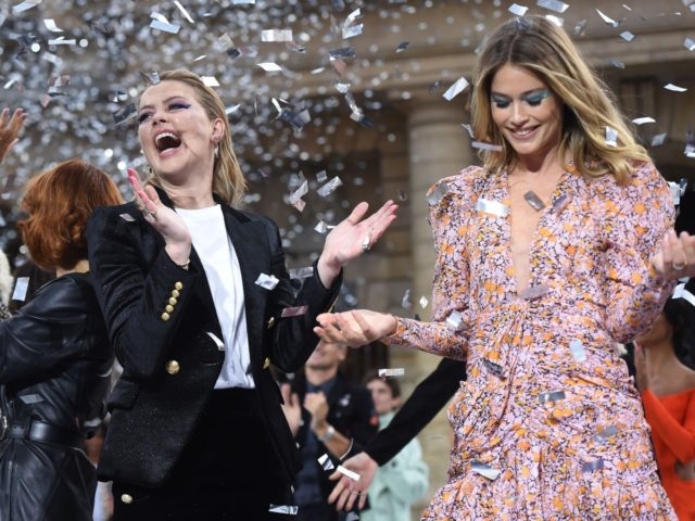 (FromL) British singer Geri Horner (formely know as Geri Halliwell), US actress Amber Heard and Dutch model Doutzen Kroes present creations for L'Oreal during the Women's Spring-Summer 2020 Ready-to-Wear collection fashion show at the Monnaie de Paris, in Paris on September 28, 2019. (Photo by Lucas BARIOULET / AFP) (Photo …