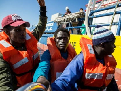 Rescued migrants from a group of 47 are transfered from their rescued unflatable boat onto the Dutch-flagged vessel Sea Watch 3 during a rescue operation off Libya's coasts on January 19, 2019. - The German charity group Sea Watch said on January 19 that it had rescued 47 migrants from …