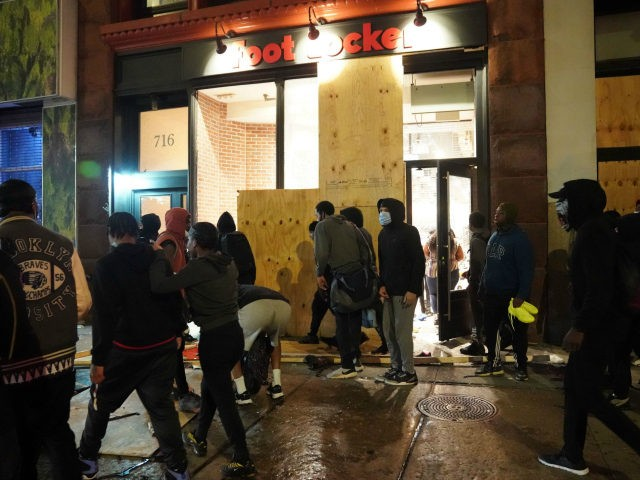 People loot a store during demonstrations over the death of George Floyd by a Minneapolis police officer on June 1, 2020 in New York. - New York's mayor Bill de Blasio today declared a city curfew from 11:00 pm to 5:00 am, as sometimes violent anti-racism protests roil communities nationwide. …
