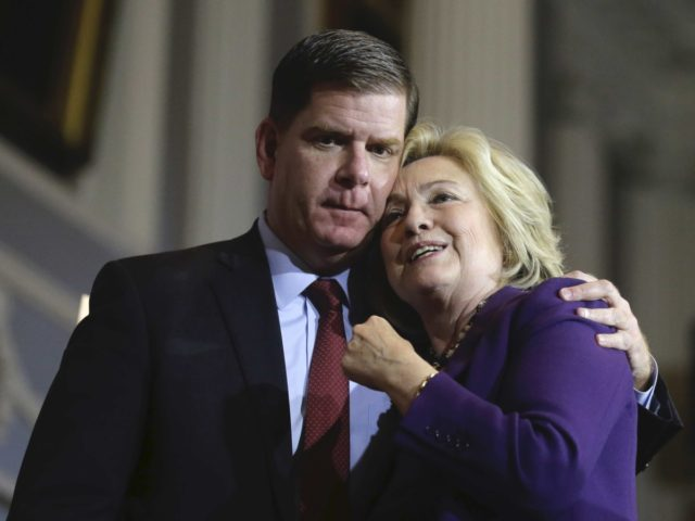 Marty Walsh and Hillary Clinton at Faneuil Hall (Stephen Senne / Associated Press)