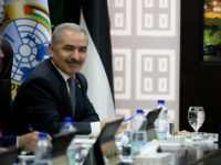 Palestinian President Mahmud Abbas (C) and Prime Minister Mohammad Shtayyeh attend a session of the weekly cabinet meeting in the occupied West Bank city of Ramallah on April 29, 2019. (Photo by Majdi Mohammed / POOL / AFP) (Photo credit should read MAJDI MOHAMMED/AFP via Getty Images)