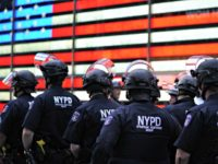 NYPD Beside a Flag