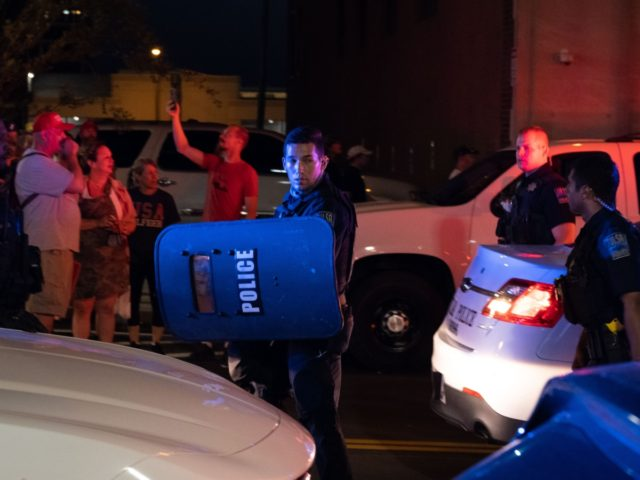 Members of the Tulsa Police Department leave the area after shooting pepper balls at protesters as they march and protest near the BOK Center in Tulsa, Oklahoma on June 20,2020 - Hundreds of supporters lined up early for Donald Trump's first political rally in months, saying the risk of contracting …