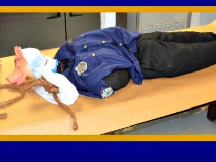 Police Mannikin Lynched