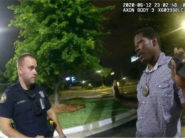 This screen grab taken from body camera video provided by the Atlanta Police Department shows Rayshard Brooks speaking with Officer Garrett Rolfe in the parking lot of a Wendy's restaurant, late Friday, June 12, 2020, in Atlanta. Rolfe has been fired following the fatal shooting of Brooks and a second …