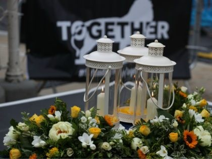 READING, UNITED KINGDOM - JUNE 27: Candles and flowers on June 27, 2020 in Reading, United Kingdom. David Wails, Joseph Ritchie-Bennett and James Furlong were killed after being attacked in Forbury Garden, shortly before 7pm on June 20, 2020. The suspect, Khairi Saadallah, has been charged with 3 counts of …