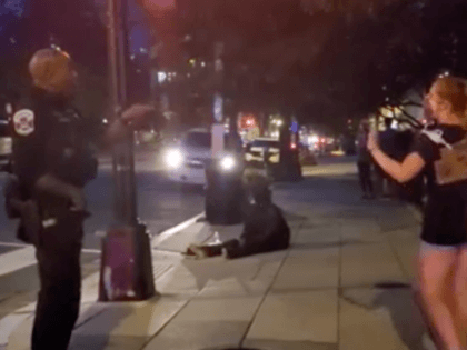 DC Metro officer lectures protester (Screenshot / Breitbart News)