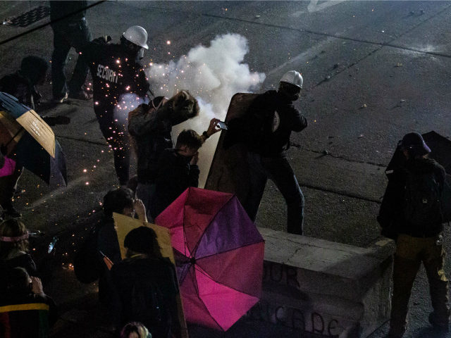 Demonstrators clash with law enforcement near the Seattle Police Departments East Precinct shortly after midnight on June 8, 2020 in Seattle, Washington. Earlier in the evening, a suspect drove into the crowd of protesters and shot one person, which happened after a day of peaceful protests across the city. Later, …