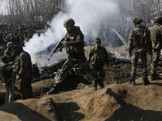 APTOPIX India Kashmir Pakistan Indian army soldiers arrive near the wreckage of an Indian aircraft after it crashed in Budgam area, outskirts of Srinagar, Indian controlled Kashmir, Wednesday, Feb.27, 2019. (AP Photo/Mukhtar Khan)