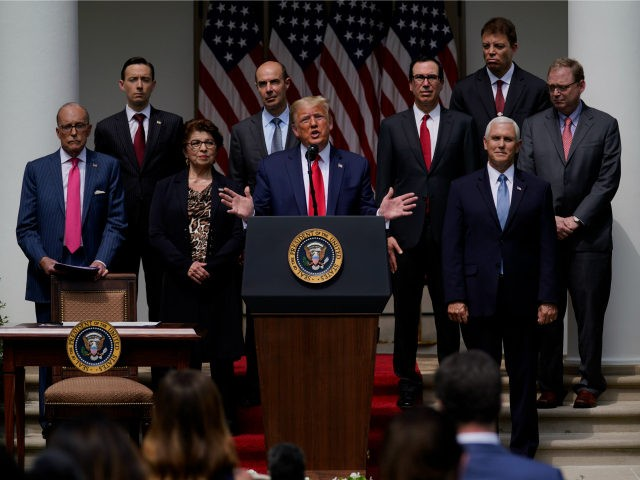 President Donald Trump speaks during a news conference in the Rose Garden of the White House, Friday, June 5, 2020, in Washington. Front row from left, White House chief economic adviser Larry Kudlow, Small Business Administration administrator Jovita Carranza, Trump, and Vice President Mike Pence. Back row from left, member …