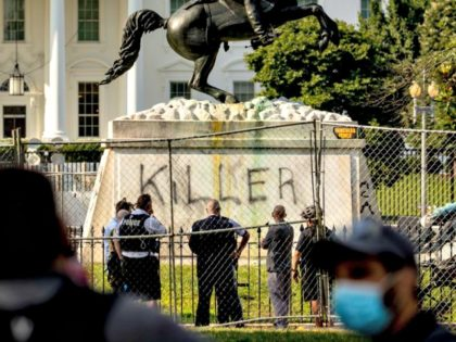 "The White House is visible behind a statue of President Andrew Jackson in Lafayette Park, Tuesday, June 23, 2020, in Washington, with the word ""Killer"" spray painted on its base. Protesters tried to topple the statue Monday night. President Tump had tweeted late Monday that those who tried to topple …"